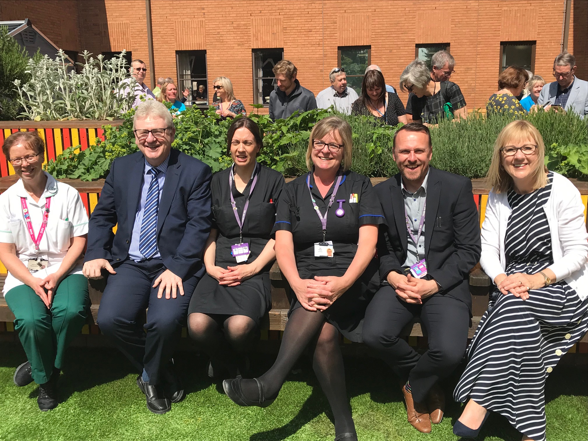 Staff enjoying the sunshine at the opening of the garden