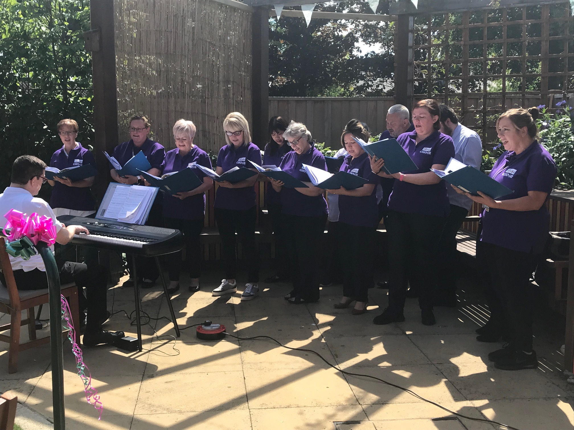 WHH Choir performing in the sunshine at the opening of the Forget Me Not Garden