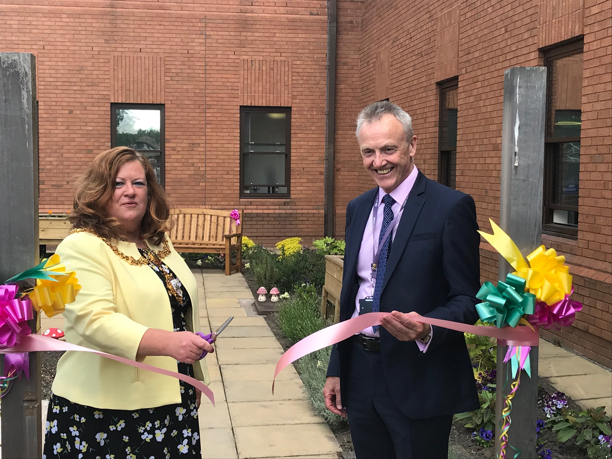 Mayor of Warrington, Cllr Wendy Johnson cutting the ribbon of the new garden with Chairman Steve McGuirk